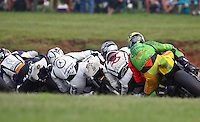 A group of riders races through a turn at the Suzuki Big Kahuna Nationals, Virginia International Raceway, Alton, VA, August 2009. (Photo by Briain Cleary/www.bcpix.com)