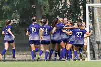NEWTON, MA - SEPTEMBER 12: Katie Quinn #23 of Holy Cross celebrates her goal with teammates during a game between Holy Cross and Boston College at Newton Campus Soccer Field on September 12, 2021 in Newton, Massachusetts.