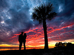 Two lovers enjoy the sunset at Shell Point Beach in Wakulla County along the panhandle of Florida.