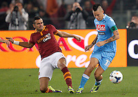 Calcio, Serie A: Roma vs Napoli. Roma, stadio Olimpico, 18 ottobre 2013.<br /> Napoli midfielder Marek Hamsik, of Slovakia, right, is challenged by AS Roma defender Leandro Castan, of Brazil, during the Italian Serie A football match between AS Roma and Napoli at Rome's Olympic stadium, 18 October 2013.<br /> UPDATE IMAGES PRESS/Riccardo De Luca