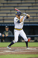 Michigan Wolverines third baseman Jake Bivens (18) at bat against the Oakland Golden Grizzlies on May 17, 2016 at Ray Fisher Stadium in Ann Arbor, Michigan. Oakland defeated Michigan 6-5 in 10 innings. (Andrew Woolley/Four Seam Images)