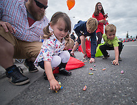 Kids scramble for candy thrown by participants in the Bear Paw Festival Grand Parade in downtown Eagle River.