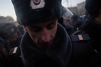 Police push back the crowd in Lubyanka Square during an unsanctioned anti-Putin demonstration in Moscow, Russia.  Police arrested a number of protesters and opposition leaders.