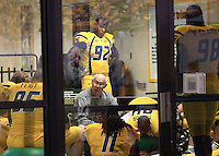 WVU defensive line coach Bill Kirelawich gives halftime instructions.  The West Virginia Mountaineers defeated the South Florida Bulls 20-6 on October 14, 2010 at Mountaineer Field, Morgantown, West Virginia.