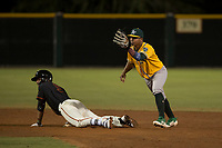 AZL Athletics shortstop Alexander Campos (8) presents the ball to the umpire after applying the tag to David Villar (9) during an Arizona League game against the AZL Giants Black at the San Francisco Giants Training Complex on June 19, 2018 in Scottsdale, Arizona. AZL Athletics defeated AZL Giants Black 8-3. (Zachary Lucy/Four Seam Images)
