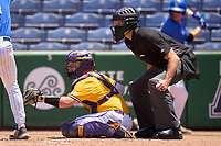 Umpire Matt McKendry and East Carolina Pirates catcher Seth Caddell (9) during a game against the Memphis Tigers on May 25, 2021 at BayCare Ballpark in Clearwater, Florida.  (Mike Janes/Four Seam Images)