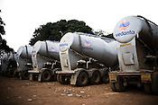 The trucks belonging to Vedanta Alumina Company are seen parked outside the refinery in Lanjigarh, Orissa.