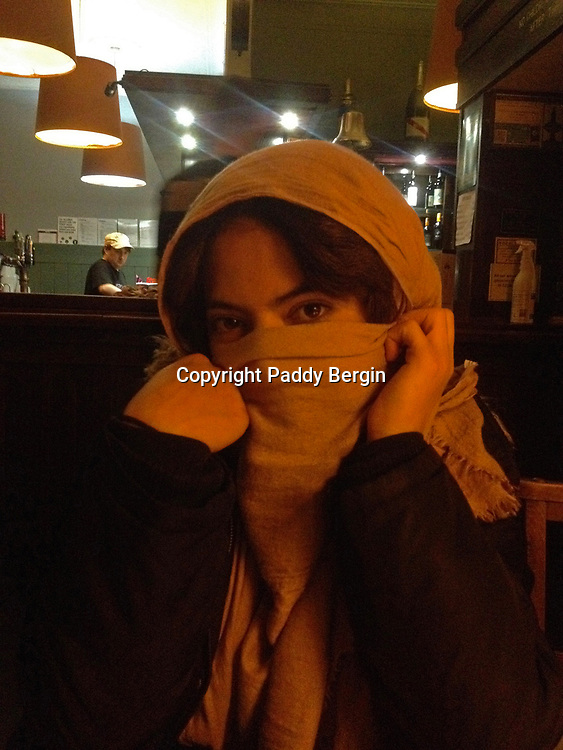 Yasmine wearing a head scarf in the pub after Aikido trainin<br /> <br /> Stock Photo by Paddy Bergin