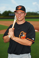 GCL Orioles catcher Alex Murphy (27) poses for a photo after a game against the GCL Rays on July 20, 2013 at Charlotte Sports Complex in Port Charlotte, Florida.  GCL Orioles defeated the GCL Rays 4-1.  (Mike Janes/Four Seam Images)