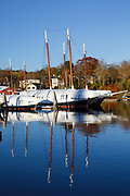 Reflection of boats in Camden Harbor in downtown Camden, Maine during the autumn months. The town of Camden is located on the coast of Maine.