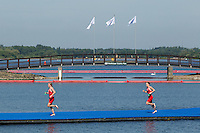 24 JUL 2014 - GLASGOW, GBR - Vicky Holland (ENG) (left) from England leads team mate Jodie Stimpson (right) from the swim during the elite women's 2014 Commonwealth Games triathlon in Strathclyde Country Park, in Glasgow, Scotland (PHOTO COPYRIGHT © 2014 NIGEL FARROW, ALL RIGHTS RESERVED)<br /> *******************************<br /> COMMONWEALTH GAMES <br /> FEDERATION USAGE <br /> RULES APPLY<br /> *******************************