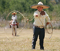V.Fiesta.1.0718.jl.jpg/photo jamie Scott Lytle/Eleven year old Jesus Salazar preforms rope trick during the Escarramuza Charra Los Golondrinas preformance held at the annual Fiesta at Guajome at Rancho Guajome Abode Saturday