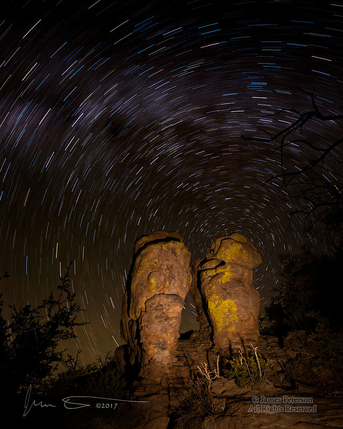 Chiricahua Twins ©2017 James D. Peterson.  Near the Massai Point trailhead in Arizona's Chiricahua National Monument, a pair of rhyolite hoodoos bask under a glorious night sky.