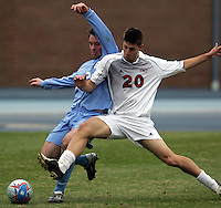 SMU's Michael Uremovich (20) muscles UNC's Blake Beach (left) off the ball. Southern Methodist University defeated the University of North Carolina 3-2 in double overtime at Fetzer Field in Chapel Hill, North Carolina, Saturday, December 3, 2005.