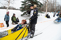 Martin Massicotte and team run past spectators on the bike/ski trail near University Lake with an Iditarider in the basket and a handler during the Anchorage, Alaska ceremonial start on Saturday, March 7 during the 2020 Iditarod race. Photo © 2020 by Ed Bennett/Bennett Images LLC