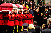 October 10, 2000 - file Photo - Montreal (Quebec) CANADA <br /> <br /> Former Canadian Prime Minister, the Honorable Pierre Eliott Trudeau children watch their fathe's coffin being carried by RCMP members, outside the Notre-Dame Basilica in Montreal (QuÈbec, Canada) on October 10th, 2000 : <br />  from left to right :<br /> Sacha Trudeau (26), Trudeau latest daughter (in purple dress), Justin Trudeau (28). Trudeau 3rd son Michel died in a tragic accident in 1998.