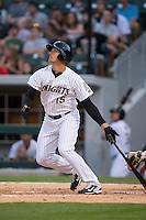 Trayce Thompson (15) of the Charlotte Knights follows through on his swing against the Norfolk Tides at BB&T BallPark on April 9, 2015 in Charlotte, North Carolina.  The Knights defeated the Tides 6-3.   (Brian Westerholt/Four Seam Images)