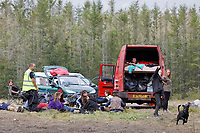 Pictured: Revellers rest on the green and their vehicles. Monday 31 August 2020<br /> Re: Around 70 South Wales Police officers executed a dispersal order at the site of an illegal rave party, where they confiscated sound gear used by the organisers in woods near the village of Banwen, in south Wales, UK.