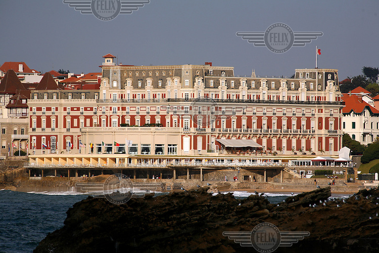 The famous Hôtel du Palais in Biarritz,France, overlooking the Grande Plage beach and the characteristic rocks at in the sea below.