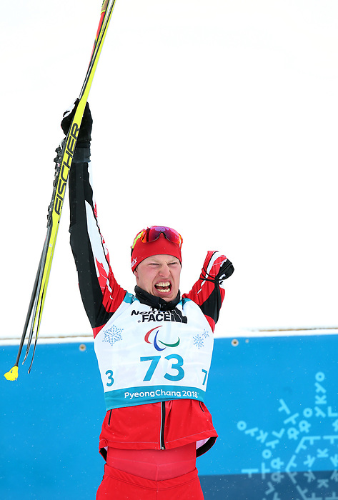 Mark Arendz, PyeongChang 2018 - Para Nordic Skiing // Ski paranordique.<br /> Mark Arendz wins gold in men's standing biathlon // Mark Arendz remporte l'or au biathlon debout maculin. 17/03/2018.