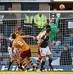 Trevor Carson saves for Motherwell