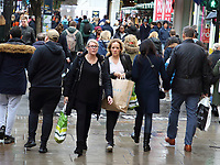 Shoppers in London's Oxford Street brave the rain and cold to get last minute presents on the finalSaturday before Christmas. Saturday December 21st 2019<br /> <br /> Photo by Keith Mayhew