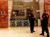 Security officers on a break in the lobby of the Trump Tower, while United States President-elect Donald Trump is holds meetings on top floors of the building, November 21, 2016, in New York, New York.<br /> Credit: Aude Guerrucci / Pool via CNP