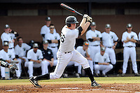 Catcher Charlie Carpenter (36) of the University of South Carolina Upstate Spartans bats in a game against the Winthrop University Eagles on Wednesday, March 4, 2015, at Cleveland S. Harley Park in Spartanburg, South Carolina. Upstate won, 12-3. (Tom Priddy/Four Seam Images)