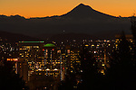 Mt. Hood is silhouetted against the golden sky of pre-dawn, Portland, Oregon