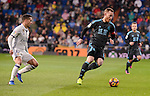 Real Madrid's Lucas Vazquez and Real Sociedad's David Zurutuza during La Liga match between Real Madrid and Real Sociedad at Santiago Bernabeu Stadium in Madrid, Spain. January 29, 2017. (ALTERPHOTOS/BorjaB.Hojas)
