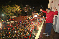 President of Venezuela Hugo Chavez waves to supporters gathered around Miraflores Palace to celebrate his  victory in the referendum that aproved a new Constitution for the country that will allow Chavez to be presidential candidate as many times as he wants.