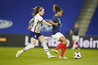 LE HAVRE, FRANCE - APRIL 13: Rose Lavelle #16 of the United States chases a ball during a game between France and USWNT at Stade Oceane on April 13, 2021 in Le Havre, France.