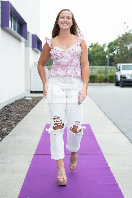 ORLANDO, FL - SEPTEMBER 11: Meggie Dougherty Howard #28 of the Orlando Pride arrives at the game before a game between Racing Louisville FC and Orlando Pride at Exploria Stadium on September 11, 2021 in Orlando, Florida.