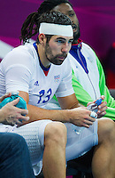 08 AUG 2012 - LONDON, GBR - Nikola Karabatic (FRA) of France recovers on the bench after needing treatment for a head injury during the men's London 2012 Olympic Games quarter final match against Spain at the Basketball Arena in the Olympic Park, in Stratford, London, Great Britain (PHOTO (C) 2012 NIGEL FARROW)