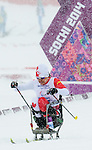 Sochi, RUSSIA - Mar 12 2014 -  Colette Bourgonje competes in the Women's 1km Sprint sitting Qualification at the 2014 Paralympic Winter Games in Sochi, Russia.  (Photo: Matthew Murnaghan/Canadian Paralympic Committee)