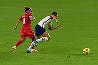 ORLANDO CITY, FL - FEBRUARY 18: Lynn Williams #6 dribbles away from Desiree Scott #11 during a game between Canada and USWNT at Exploria stadium on February 18, 2021 in Orlando City, Florida.