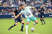 KANSAS CITY, KS - AUGUST 10: Ángel Mena #13 Club Leon tries aback heel during a game between Club Leon and Sporting Kansas City at Children's Mercy Park on August 10, 2021 in Kansas City, Kansas.