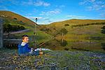 Peyton fishing at the catfish pond, San Luis Obispo, California