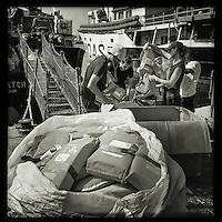 Sea Watch-2.<br /> Die Crew bereitet das Schiff auf die 13. SAR-Mission vor.<br /> Im Bild: Mehrere hundert gespendeter Schwimmwesten werden sortiert und beschriftet.<br /> 16.10.2016, Valetta/Malta<br /> Copyright: Christian-Ditsch.de<br /> [Inhaltsveraendernde Manipulation des Fotos nur nach ausdruecklicher Genehmigung des Fotografen. Vereinbarungen ueber Abtretung von Persoenlichkeitsrechten/Model Release der abgebildeten Person/Personen liegen nicht vor. NO MODEL RELEASE! Nur fuer Redaktionelle Zwecke. Don't publish without copyright Christian-Ditsch.de, Veroeffentlichung nur mit Fotografennennung, sowie gegen Honorar, MwSt. und Beleg. Konto: I N G - D i B a, IBAN DE58500105175400192269, BIC INGDDEFFXXX, Kontakt: post@christian-ditsch.de<br /> Bei der Bearbeitung der Dateiinformationen darf die Urheberkennzeichnung in den EXIF- und  IPTC-Daten nicht entfernt werden, diese sind in digitalen Medien nach §95c UrhG rechtlich geschuetzt. Der Urhebervermerk wird gemaess §13 UrhG verlangt.]