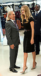 """.Rosie Huntington-Whitely..At M&S Oxford St.to promote her new range of underwear - lingerie -.""""Rosie for Autograph."""".On the way in she paused to kiss Steven Sharp. Executive Director, Marketing  at M&S..Pic by Gavin Rodgers/Pixel 8000 Ltd"""
