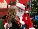Students get their photo with Santa at the 10th annual Holiday with a Hero event at Walmart in Carson City, Nev., on Wednesday, Dec. 17, 2014. The event pairs 200 of Carson City's K-5th grade homeless students with a local heroes for Christmas shopping. <br /> Photo by Cathleen Allison