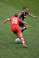 Washington Freedom's Abby Wambach puts the moves on LA Sol's Brittney Bock  . The LA Sol defeated the Washington Freedom 2-0 in the opening game of Womens Professional Soccer at Home Depot Center stadium on Sunday March 29, 2009.  .Photo by Michael Janosz