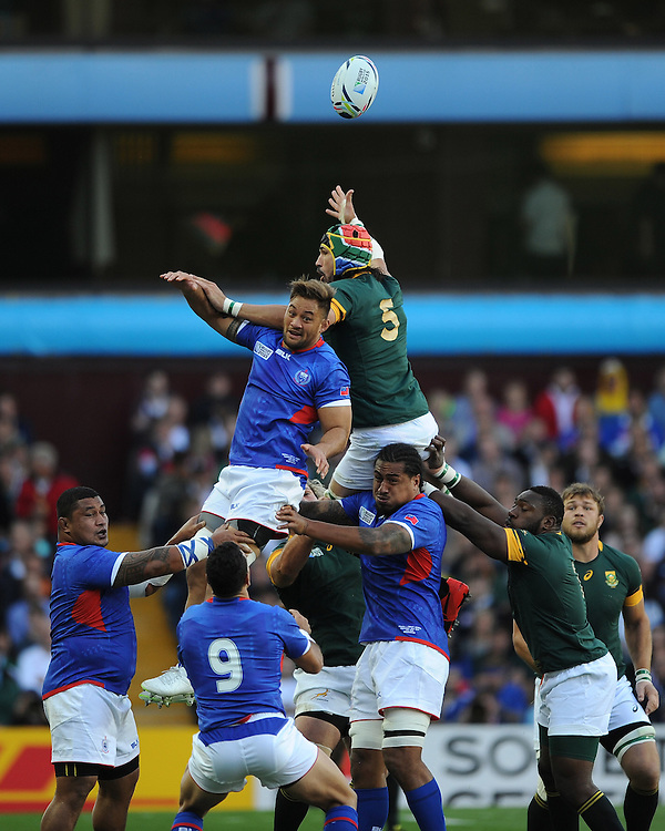 Victor Matfield of South Africa spoils the linnet for Jack Lam of Samoa during Match 15 of the Rugby World Cup 2015 between South Africa and Samoa - 26/09/2015 - Villa Park, Birmingham<br /> Mandatory Credit: Rob Munro/Stewart Communications