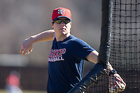 Shippensburg Raiders assistant coach Adam Sheibley throws batting practice prior to the game against the Belmont Abbey Crusaders at Abbey Yard on February 8, 2015 in Belmont, North Carolina.  The Raiders defeated the Crusaders 14-0.  (Brian Westerholt/Four Seam Images)