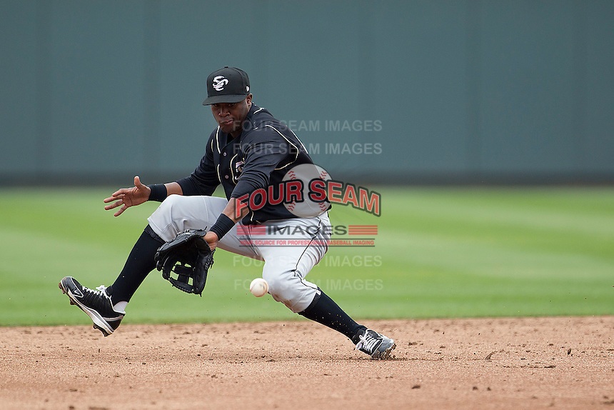 Omaha Storm Chasers shortstop Irving Falu #12 fields a grounder against the Round Rock Express in the Pacific Coast League baseball game on April 7, 2013 at the Dell Diamond in Round Rock, Texas. Omaha beat Round Rock 5-2, handing the Express their first loss of the season. (Andrew Woolley/Four Seam Images).
