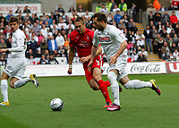 Pictured: Stepehn Dobbie causes the notts forest defense a few problems here he takes on Luke Chambers<br /> Swansea City FC (white) V Nottingham Forest (red) Championship play off semi final, second leg. Liberty Stadium Swansea 16/05/11<br /> Picture by: Ben Wyeth  / Athena Picture Agency<br /> info@athena-pictures.com