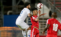 GEORGETOWN, GRAND CAYMAN, CAYMAN ISLANDS - NOVEMBER 19: DeAndre Yedlin #2 of the United States heads a ball past Rolando Abreu #7 of Cuba during a game between Cuba and USMNT at Truman Bodden Sports Complex on November 19, 2019 in Georgetown, Grand Cayman.