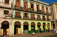 Havana Cuba Habana in front of old worn and colorful apartment buildings in downtown city