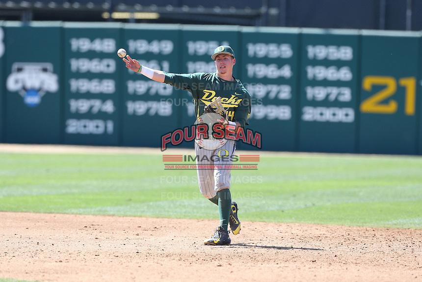 Mark Karaviotis (1) of the Oregon Ducks makes a throw during a game against the Southern California Trojans at Dedeaux Field on April 18, 2015 in Los Angeles, California. Oregon defeated Southern California, 15-4. (Larry Goren/Four Seam Images)