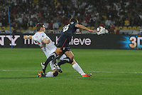 England's Frank Lampard fouls U.S. defender Steve Cherundolo during the team's debut match in the 2010 FIFA World Cup. The U.S. and England played to a 1-1 draw in the opening match of Group C play at Rustenburg's Royal Bafokeng Stadium, Saturday, June 12th.
